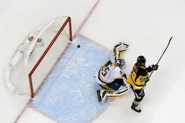PITTSBURGH, PA - MAY 29: Jake Guentzel #59 of the Pittsburgh Penguins scores a goal past Pekka Rinne #35 of the Nashville Predators in Game One of the 2017 NHL Stanley Cup Final at PPG Paints Arena on May 29, 2017 in Pittsburgh, Pennsylvania.  (Photo by Kirk Irwin/Getty Images)