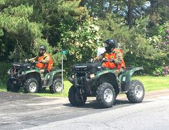 BRUCE BELL/THE INTELLIGENCER Members of the Ontario Provincial Police Emergency Repsonse Team search along County Road 28 in Ameliasburgh for David Franks, a 24-year-old County resident who was last seen on Thursday morning.