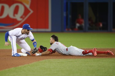 TORONTO, ON - MAY 30:  Billy Hamilton #6 of the Cincinnati Reds steals second base ahead of the tag by Devon Travis #29 of the Toronto Blue Jays in the seventh inning at Rogers Centre on May 30, 2017 in Toronto, Canada. (Photo by Tom Szczerbowski/Getty Images)