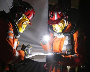 Glencore Sudbury Integrated Nickel Operations mine rescue team members captain Andrew Jorgensen and Rock Carriere document conditions, location and airflow throughout the competition during the district mine rescue competition in Sudbury, Ont. on Thursday May 11, 2017. Gino Donato/Sudbury Star/Postmedia Network
