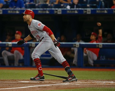 Cincinnati Reds Joey Votto 1B (19) watches the ball sail over the centre field fence for a two-run homer in the first inning  in Toronto, Ont. on Wednesday May 31, 2017. Jack Boland/Toronto Sun/Postmedia Network