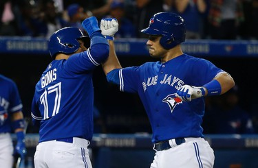 Toronto Blue Jays Luke Maile C (22) punches fist sight Ryan Goins (17) after crushing a ball to centre field for a two-run HR in the fifth inning  in Toronto, Ont. on Wednesday May 31, 2017. Jack Boland/Toronto Sun/Postmedia Network