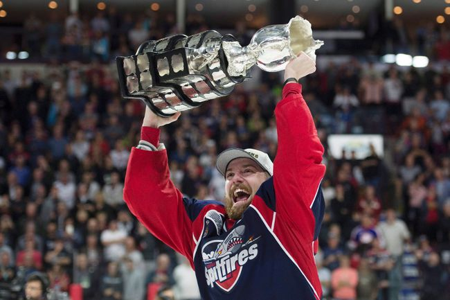 Windsor Spitfires centre Aaron Luchuk, who scored the game-winning goal, raises the trophy after defeating the Erie Otters to win the Memorial Cup in Windsor. The Kingston native was traded to Barrie this week. (THE CANADIAN PRESS/Adrian Wyld)