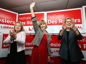 Nathalie Des Rosiers, centre, celebrates her Vanier byelection win with Madeleine Meilleur, left, and Kathleen Wynne in November 2016. A new bill proposed by Des Rosiers states Ottawa would have to have a bylaw on offering city services in English and French, but that really wouldn't change much of anything, writes David Reevely. JEAN LEVAC / POSTMEDIA