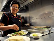 Ana Rivas, head chef at True Taco on Dundas Street, prepares a trio of authentic Mexican tacos. True Taco is one of eight local restaurants taking part in Fiesta London June 3. CHRIS MONTANINI\LONDONER\POSTMEDIA NETWORK