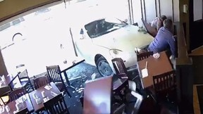 On Tuesday, a car crashed through the window at Silk's Country Kitchen in Niagara-on-the-Lake, Ont., pinning two men against the wall. The men weren't seriously hurt. (Blair Robertson/Facebook)