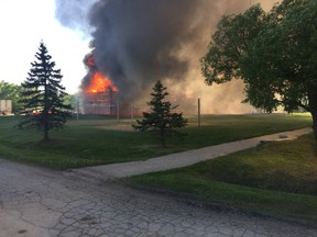 Fire has extensively damaged a large college dormitory south of Winnipeg. The building at Providence University College in Otterburne was undergoing exterior renovations when flames tore through the structure late in the afternoon, June 1, 2017. Handout