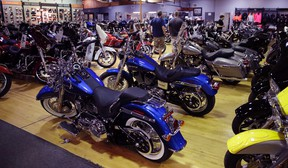 In this Monday, April 24, 2017, photo, Harley-Davidson motorcycles are displayed on the showroom floor at the Motorcycles of Manchester dealership in Manchester, N.H. (AP Photo/Charles Krupa)