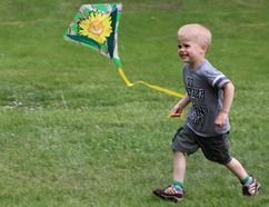 Three-year-old Kole Schoonbaert wasn't shy to show his enthusiasm as he took part in Morden's first Kite Festival May 26. (GREG VANDERMEULEN/Morden Times)