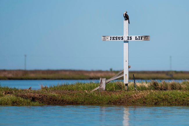 """A cross stands at the mouth of the harbor reading """"Jesus is Life""""  in Tangier, Virginia. Rev. Larry Blaikie offers three simple things one can do to stay connected. Postmedia Network"""