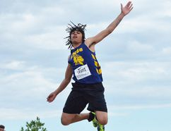 Kieran Lewis (ENSS) reaches for the sky during junior boys long jump competition Friday at the 2017 OFSAA track and field championships at the MAS Park complex. (Catherine Frost for The Intelligencer)