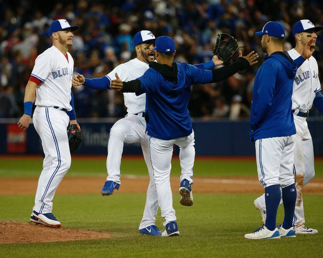 Toronto Blue Jays Devon Travis 2B (29) celebrates the 7-5 win with Marcus Stroman in Toronto, Ont. on Friday June 2, 2017. Jack Boland/Toronto Sun/Postmedia Network