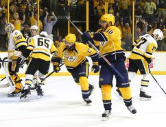 Viktor Arvidsson (right) of the Nashville Predators celebrates a second-period goal against the Pittsburgh Penguins in Game 3 of the Stanley Cup final at the Bridgestone Arena in Nashville, Tenn. last night. The Preds won 5-1. (Getty Images)