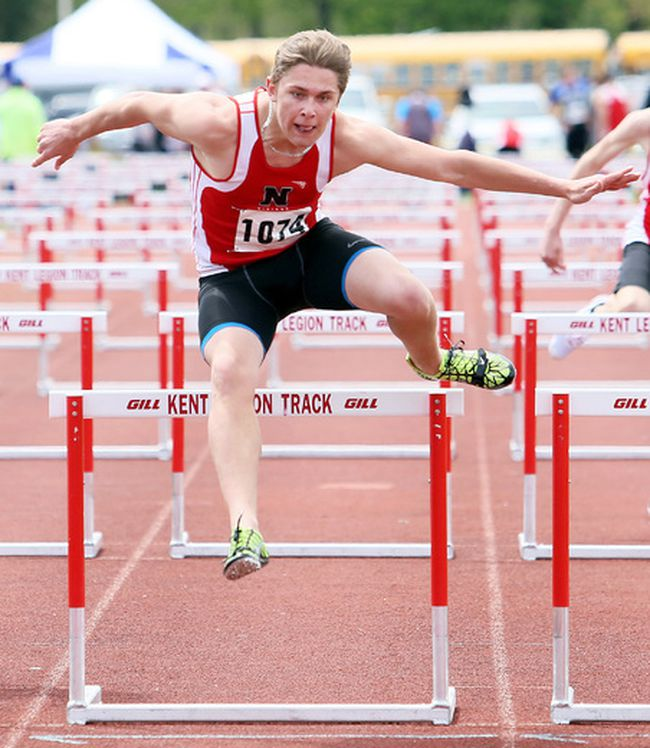 Avery Smiley of Northern wins the midget boys' 100-metre hurdles during Day 1 of the LKSSAA track and field championship at the Chatham-Kent Community Athletic Complex in Chatham, Ont., on Tuesday, May 9, 2017. (MARK MALONE/Postmedia Network)