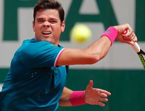 Canada's Milos Raonic plays a shot against Spain's Pablo Carreno Busta during their fourth round match at the French Open in Paris, France on Sunday, June 4, 2017. (Christophe Ena/AP Photo)