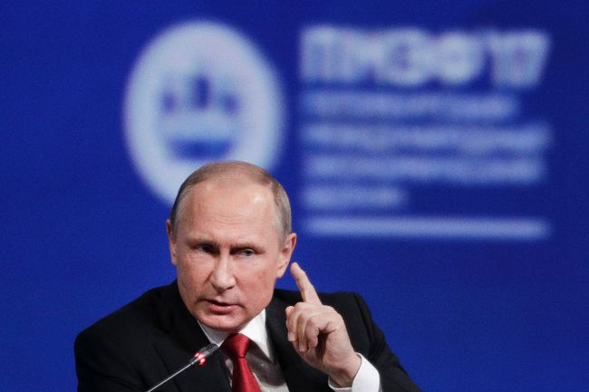 """In this Friday, June 2, 2017, file photo, Russian President Vladimir Putin gestures as he speaks at the St. Petersburg International Economic Forum in St. Petersburg, Russia. Putin is dismissing as """"a load of nonsense"""" the idea that Russia has damaging information on President Donald Trump and denies having any relationship with him, said Putin in an interview with NBC's """"Sunday Night with Megyn Kelly."""" (AP Photo/Dmitry Lovetsky, File)"""