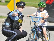 Ethan Dickson, 5, of Mitchell, received some pointers from OPP Auxiliary Officer Connor Dewbury during the annual Optimist Club of Mitchell Bike Rodeo last Saturday, June 3 at the West Perth fire hall in Mitchell. ANDY BADER/MITCHELL ADVOCATE