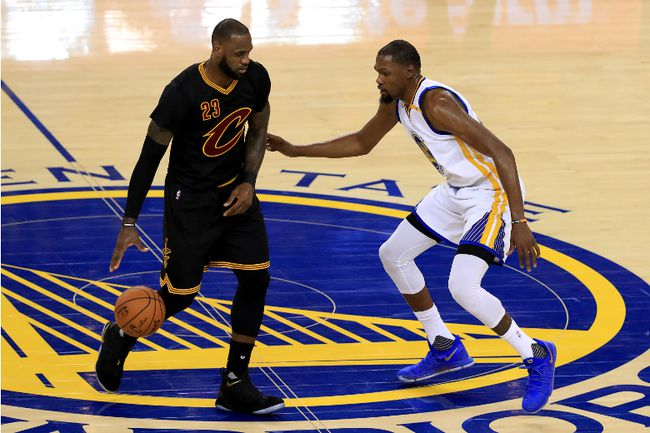 LeBron James #23 of the Cleveland Cavaliers is defended by Kevin Durant #35 of the Golden State Warriors during the second half of Game 2 of the 2017 NBA Finals at ORACLE Arena on June 4, 2017 in Oakland, California. (Photo by Ronald Martinez/Getty Images)