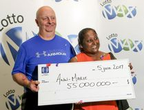 Ann-Marie Francis and husband Ian Warcup with their $55-million cheque for having won the June 2 Lotto Max draw during a ceremony in Montreal Monday June 5, 2017. (John Mahoney/POSTMEDIA)
