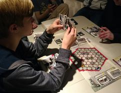 PHOTO SUPPLIED - Kids at the South Pointe Community Centre play test Carthage, a locally-made deck-building game. Designed by SAS Creative, the gladiator-themed game will be rolled out into local stores in the coming months.