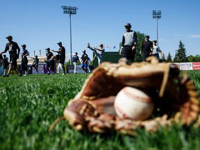 Players warm up during the Edmonton Prospects' open tryouts at Re/Max Field in Edmonton on Saturday, May 27, 2017.
