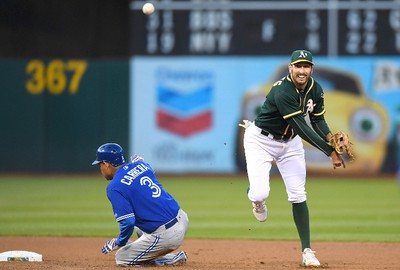 OAKLAND, CA - JUNE 06:  Adam Rosales #16 of the Oakland Athletics completes the double-play getting his throw off over the top of Ezequiel Carrera #3 of the Toronto Blue Jays in the top of the fourth inning at Oakland Alameda Coliseum on June 6, 2017 in Oakland, California.  (Photo by Thearon W. Henderson/Getty Images)