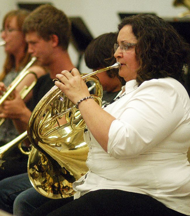 Wallaceburg Community Concert Band member Debi Shattler performs on the French Horn, during the concert band's community concert held on Tuesday, May 30 at Wallaceburg District Secondary School.