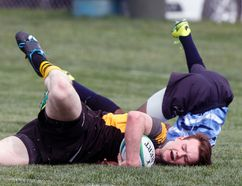 Banff Academy Bears captain Ducan Thorburn touches the ball down for a try to help his team to a 23-19 victory over Strathcona-Tweedsmuir Spartans at the South Central Alberta Tier 3 zone championships Thursday in Calgary.
