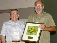 Larry Cornelis, right, receives the Ontario Nature Achievement Award from Otto Peter, of Ontario Nature. (Handout)