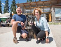 Apollo, an 11 year old mixed breed German shepherd, attends the BVSPCA's 10th anniversary barbecue with his owner Kelly Sykes, left, and original board member Sue Donnelly. (Pam Doyle/ Bow Valley Crag & Canyon/ Postmedia Network)