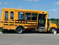 A crash involving this school bus and two other vehicles on London's outskirts sent eight people, including six students, to hospital Wednesday. The bus driver faces a Highway Traffic Act charge. (OPP supplied photo)
