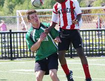John Grilles, left, of Horizon Aigles, and a Macdonald-Cartier Pantheres player battle for the ball during boys high school soccer division II final action at James Jerome Sports Complex in Sudbury, Ont. on Thursday June 8, 2017. John Lappa/Sudbury Star/Postmedia Network