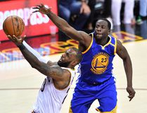 LeBron James of the Cleveland Cavaliers attempts a shot while Draymond Green of the Golden State Warriors defends in Game 4 of the NBA Finals at Quicken Loans Arena on June 9, 2017 in Cleveland. (Jason Miller/Getty Images)