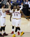 Cavaliers forward LeBron James (23) celebrates with Kevin Love (0) and Kyrie Irving (2) during the first half against the Warriors in Game 4 of the NBA Finals in Cleveland on Friday, June 9, 2017. (Ron Schwane/AP Photo)