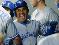 Ezequiel Carrera is all smiles after hitting one of three Jays homers in last night's 4-2 win over the Mariners in Seattle. (Ted Warren, AP)