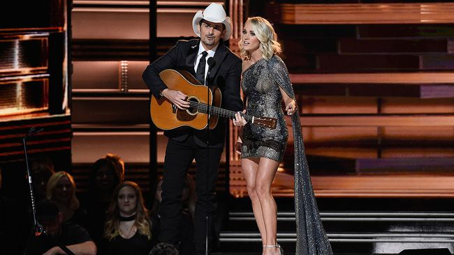 Co-hosts Brad Paisley and Carrie Underwood perform onstage at the 50th annual CMA Awards at the Bridgestone Arena on Nov. 2, 2016 in Nashville, Tenn. (Gustavo Caballero/Getty Images)