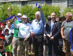 From left, K&P Trail advocate Douglas Knapp (with cane), King's Town District Councillor Rob Hutchison and Mayor Bryan Paterson cut a ribbon at the grand opening of the K&P Trail at Douglas Fluhrer Park on Saturday. (Joseph Cattana/For The Whig-Standard)