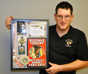 Tim Horton announced his retirement after 10-years as equipment manager of the Mitchell Jr. C Hawks. He recently received this gift thanking him for his work and dedication over the years. ANDY BADER/MITCHELL ADVOCATE