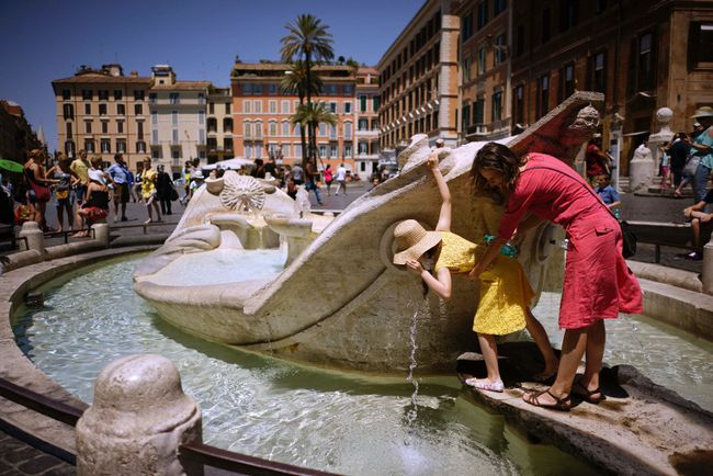 People drink from Italian 17th Century sculptor Bernini's Barcaccia fountain, just next to the Spanish steps, in Rome, Monday, June 12, 2017. City hall on Monday announced that Mayor Virginia Raggi had signed an ordinance aimed at protecting some 40 fountains of historic or artistic interest to try to protect the monumental works, not infrequently trashed by tourists, sports fans and Romans. (AP Photo/Andrew Medichini)