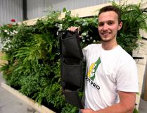 Matt Clarke of RootPro Vertical Gardens shows his hanging planters made from geotextile at his Thorndale business. (MIKE HENSEN, The London Free Press)
