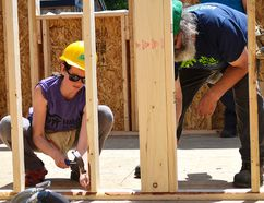 Colleen Raes, left, and Ted Postma help secure an interior wall in the early afternoon Saturday. Habitat for Humanity relies on volunteers like them to keep their projects and community store sustained, and say with more help they could actually attempt a second build each summer.