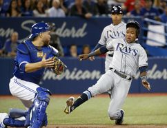Rays Tim Beckham is tagged out at home by Russell Martin as the Blue Jays beat the Tampa Bay Rays 4-1 at the Rogers Centre in Toronto, Ont. on April 29, 2017. (Michael Peake/Toronto Sun)