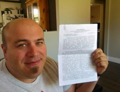 Jamie Stephens holds a two-page document that he brought back from Russia after a trip to Sochi to compete in a PokerStars tournament. (Vincent Ball/The Expositor)