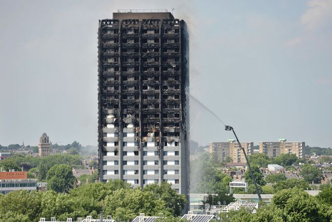 Firefighters spray water onto the 24-storey apartment block in west London. Wednesday June 14, 2017.  ???Firefighters are searching the charred 24-storey apartment tower in London after a deadly overnight fire raced through it. Police say there were fatalities with more than 70 othersinjured in the blaze that sent black smoke over the British capital. (Victoria Jones/PA via AP) ORG XMIT: TH810