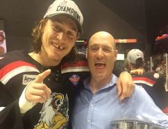 Sudbury native Tyler Bertuzzi celebrates his Calder Cup win and playoff MVP nod with his dad, Adrian Geyde, in Grand Rapids, Mich., on Tuesday night. Suppled photo