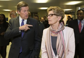 Toronto Mayor John Tory needs Ontario Premier Kathleen Wynne to pony up so the city can get much-needed federal funding for housing and transit. (STAN BEHAL/TORONTO SUN FILES)