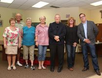 From left to right, Airdrie 50 plus club board members Judy and Barry Sansom, Lorna Wendell and Myrtle Brewster stand alongside Airdrie Mayor Peter Brown, McKee Homes president Elaine Doel and 2017 election council candidate Tim Lowing stand inside the 50 plus club. The club held an open house on Wednesday, June 7