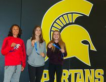 CW Perry Spartan tracks and field aggregate champions Tristan Remus, left, Sara Zinck and Amanda Paquette show off their medals at CW Perry School in Airdrie on Friday, June 9, 2017. The grade seven and eight students accumulated the most points for their track and field team helping their team to the win the Zone championship.
