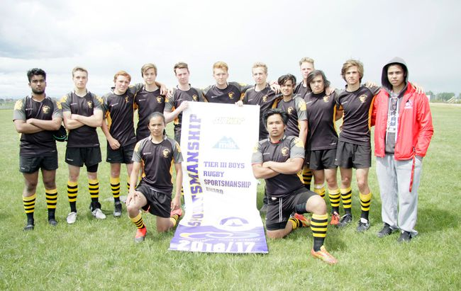 The graduating members of the Banff Commuinity High School Bears rugby program include: front row, left to right, Marlou Lerma and Jasper Dimarucut; back row, left to right, Druvar Moola, Xander Harvey, Danny Scurfield, Liam McCarney, Duncan Thorburn, Seamus O`Farrell, Andrew Lapierre, Dominic Vollenwieder, Findley Wallace, Kyle Wingrowich, Max Lozeman and River Ross.The palyers are posing with the sportsmanship banner won at the Tier 3 provincial championships played in High Rive, Alta. on Friday and Saturday, June 9-10, 2017. (Russ Ullyot/ Bow Valley Crag & Canyon/ Postmedia Network)