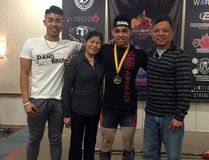 Brockville powerlifter Christopher Dang (second from the right) stands with some of his family members Jordan Dang, Ha Dang, and My Dang. (Contributed photo)
